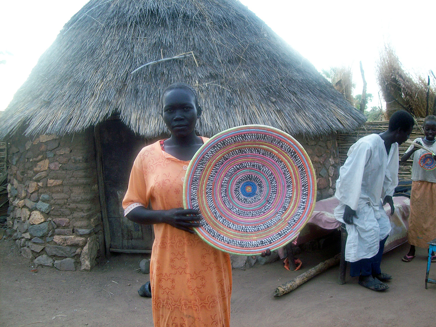 Proudly displaying hand-woven basket. Courtesy Yaunis Andini