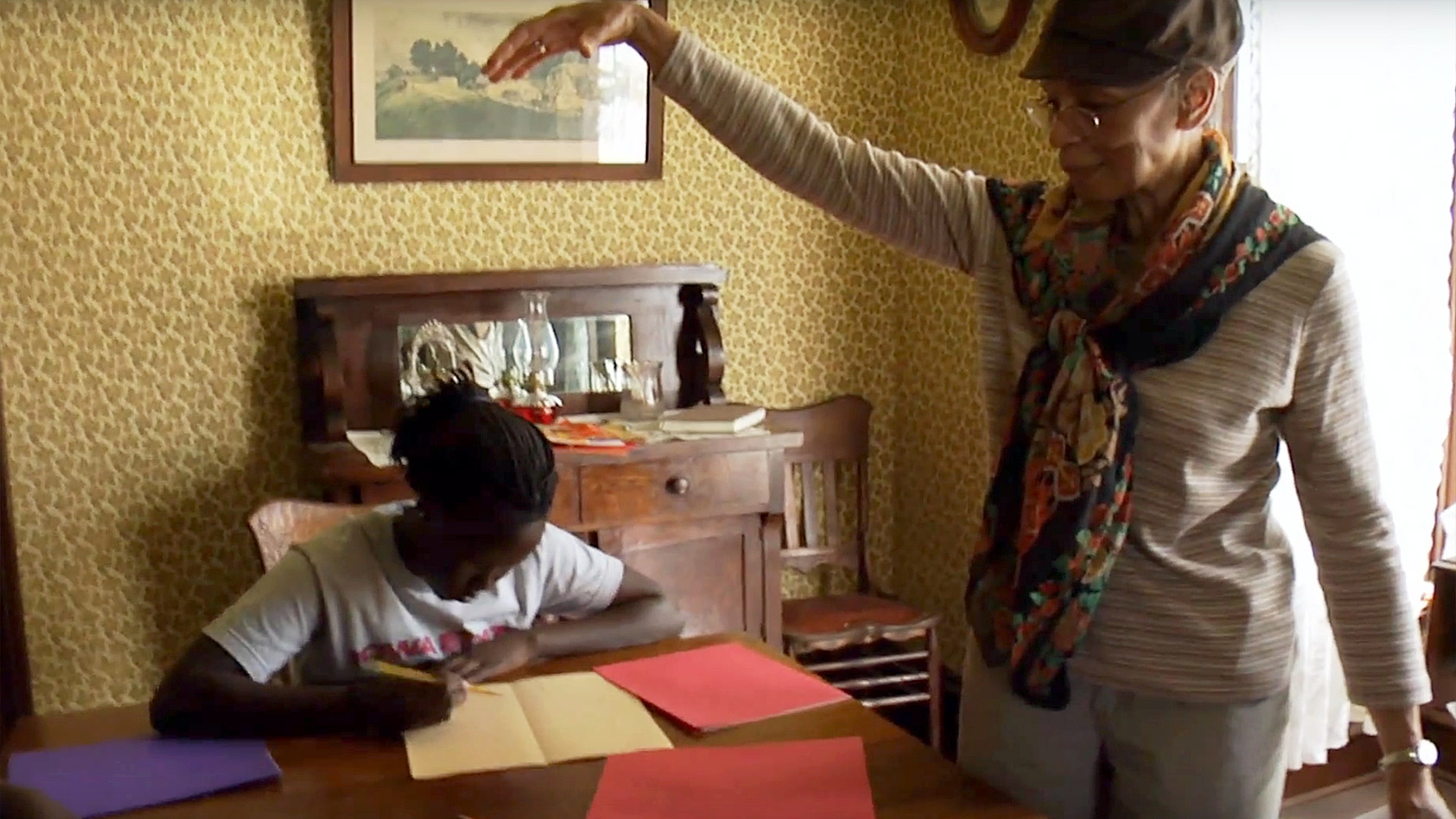 "Peggie models a ""slam dunk"" for Nyador to sketch. From the documentary The Quilted Conscience"
