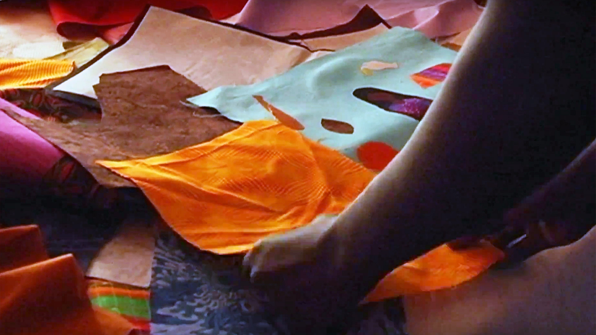 The next step after sketching is selecting the fabric. From the documentary The Quilted Conscience
