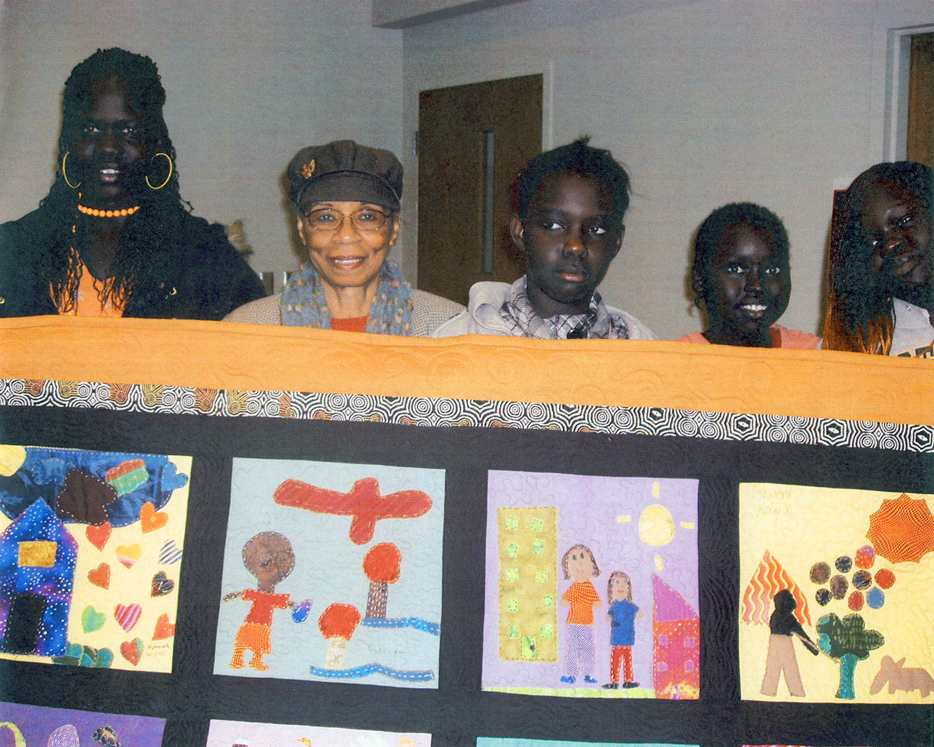 Peggie Hartwell & a few of the young quilters. Courtesy Tracy Morrow