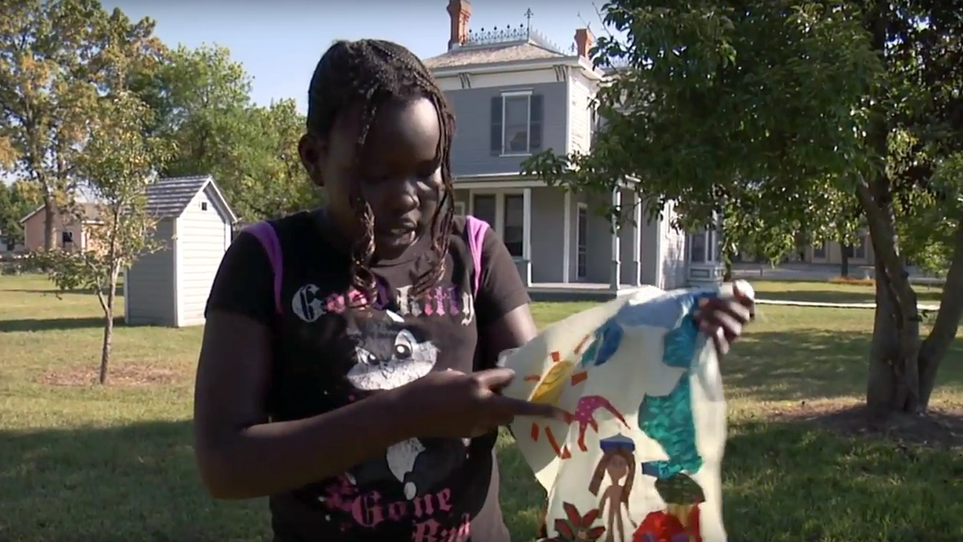 Nyabiel shows off her Memories block at the Stuhr Museum. From the documentary The Quilted Conscience