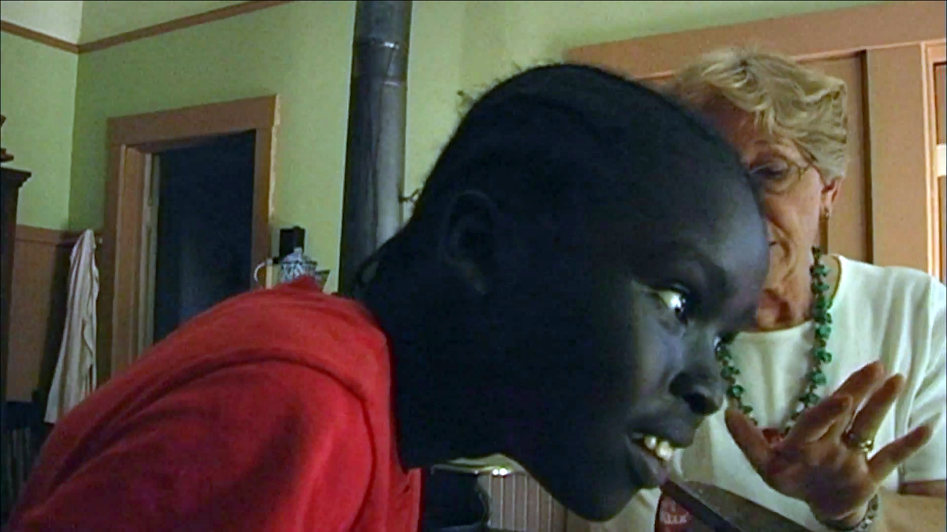Chol listens to a hot iron sizzle. From the documentary The Quilted Conscience