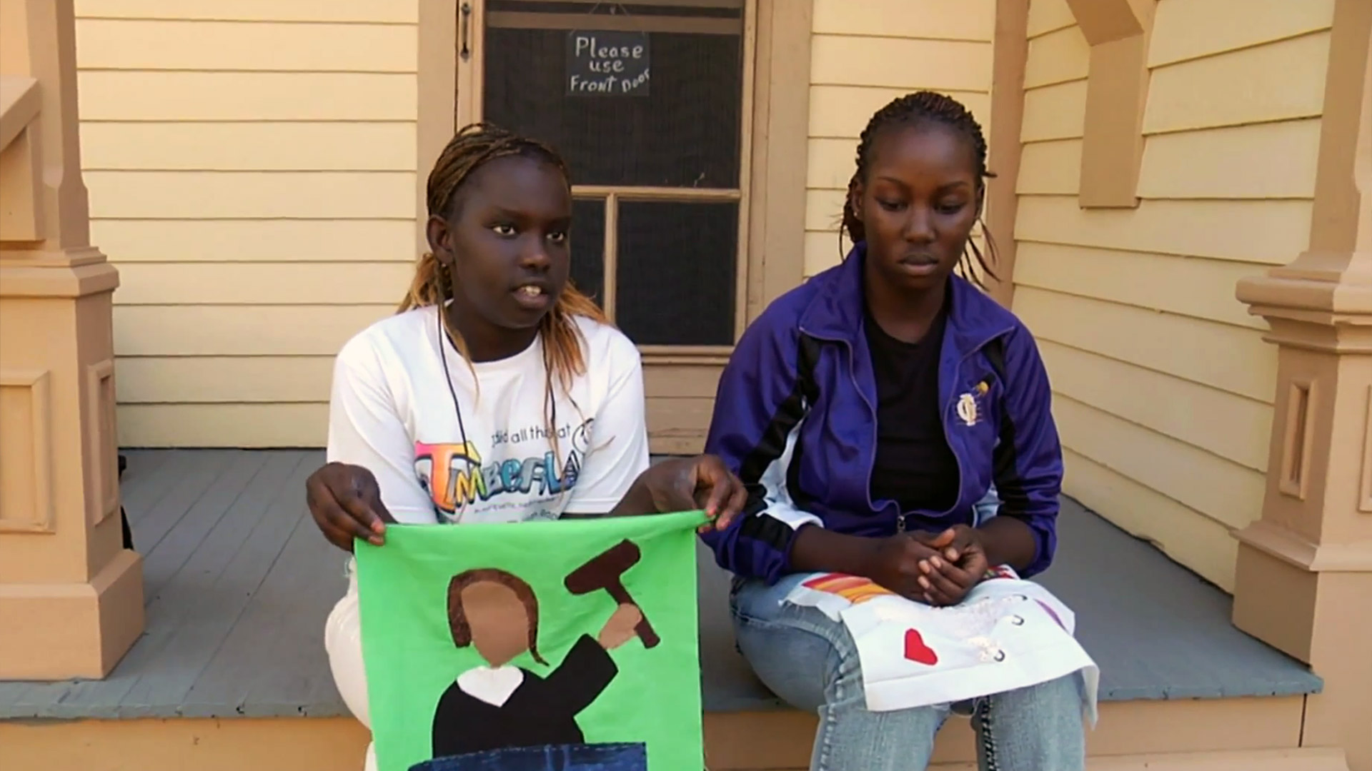 Nyarieka & Neesha explain their Dreams blocks at the Stuhr Museum. From the documentary The Quilted Conscience