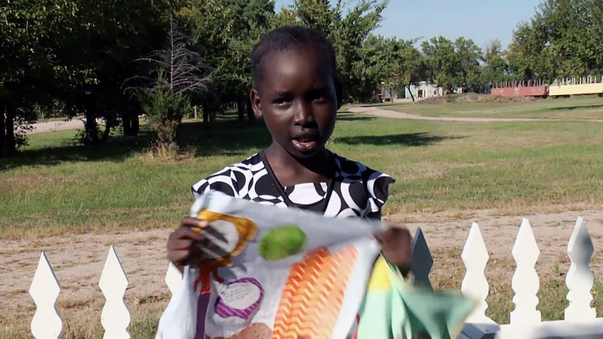 Nyamuoch explains her Dreams block at the Stuhr Museum. From the documentary The Quilted Conscience