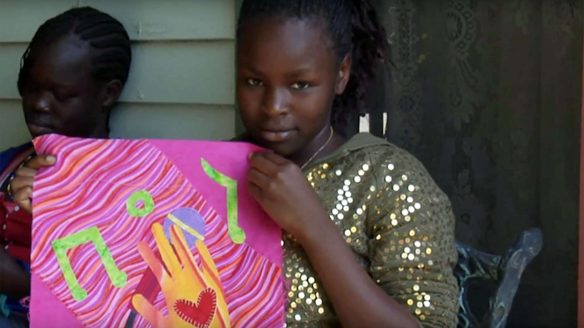 Yomaz shows off her Dreams block at the Stuhr Museum. From the documentary The Quilted Conscience