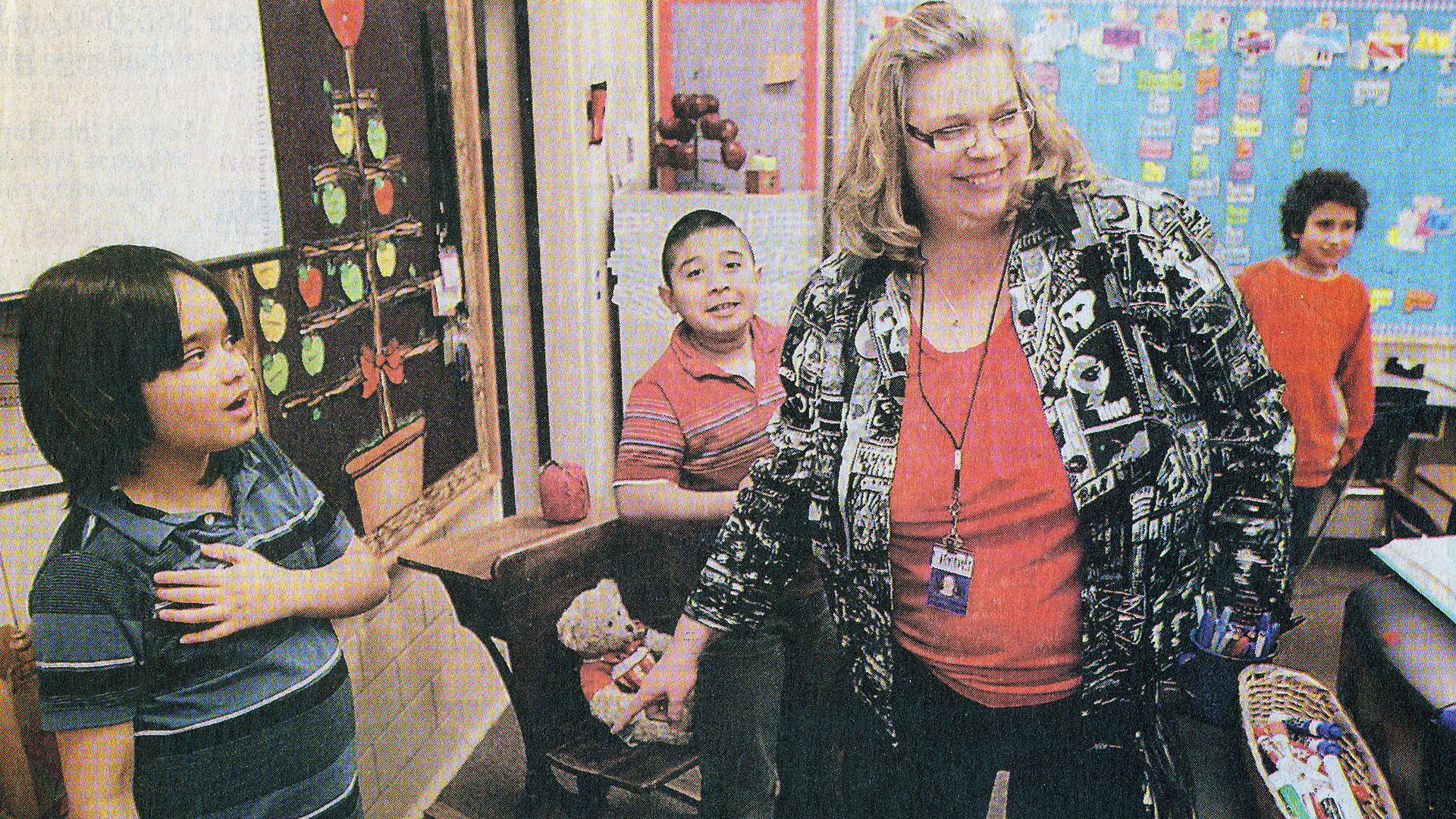 Newcomers teacher Tracy Morrow arranges students Jorge, Jonathan, and Jesus to help illustrate the idea of patterns during science class. Property of The Grand Island Independent http://theindependent.com