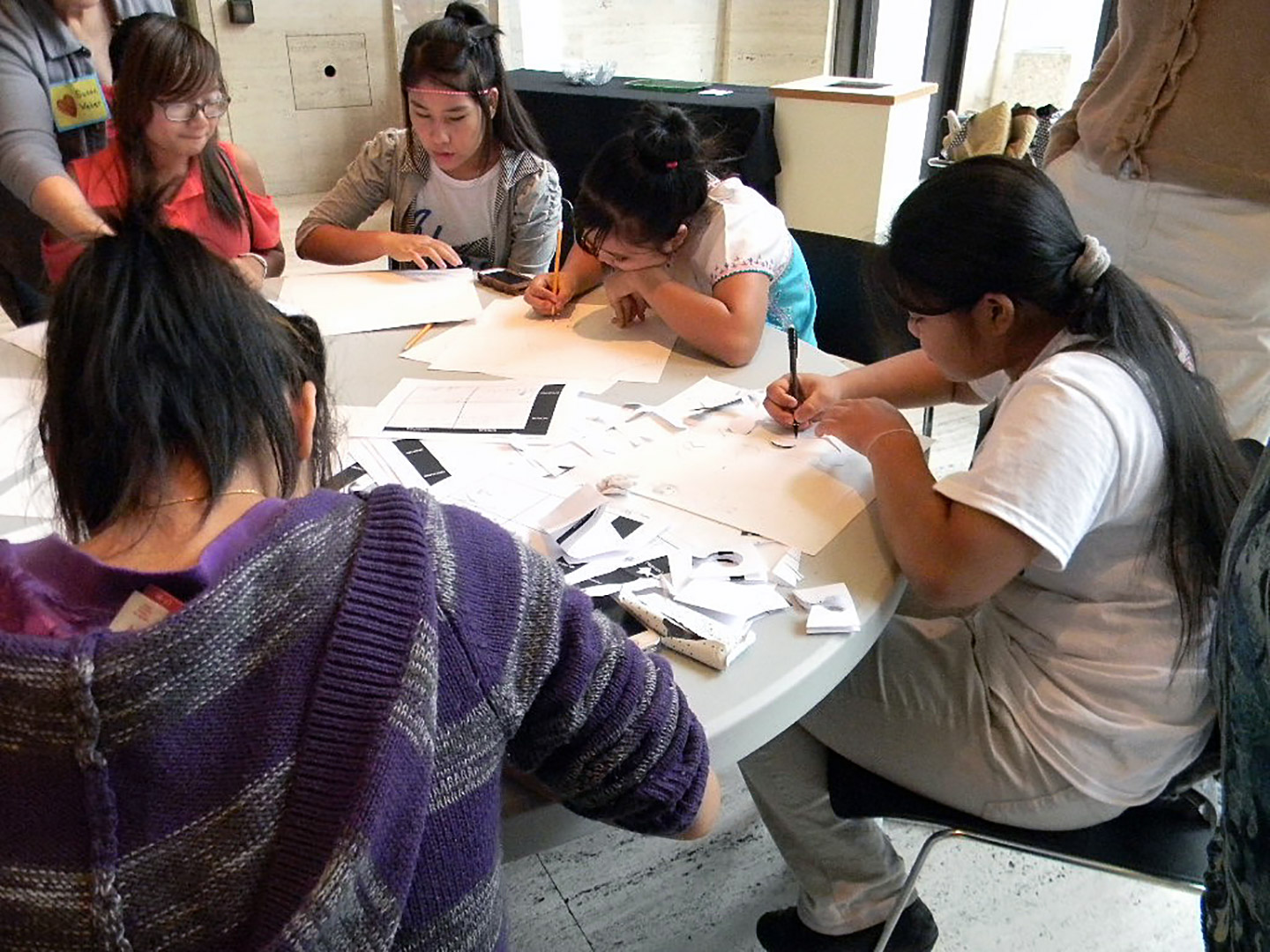 Young quilters sketching. Courtesy Susan Hertzler, Lincoln H.S.