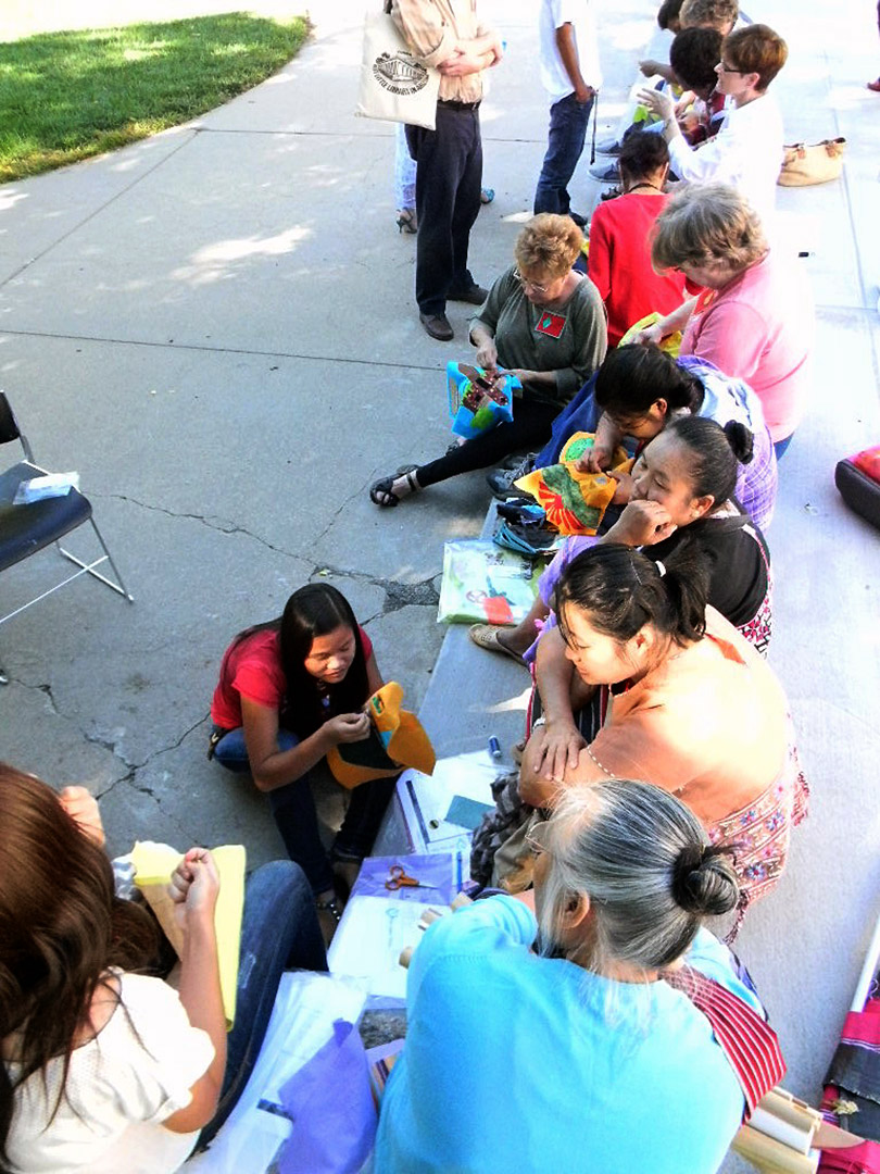 The quilting team enjoys sewing outside. Courtesy Susan Hertzler, Lincoln H.S.