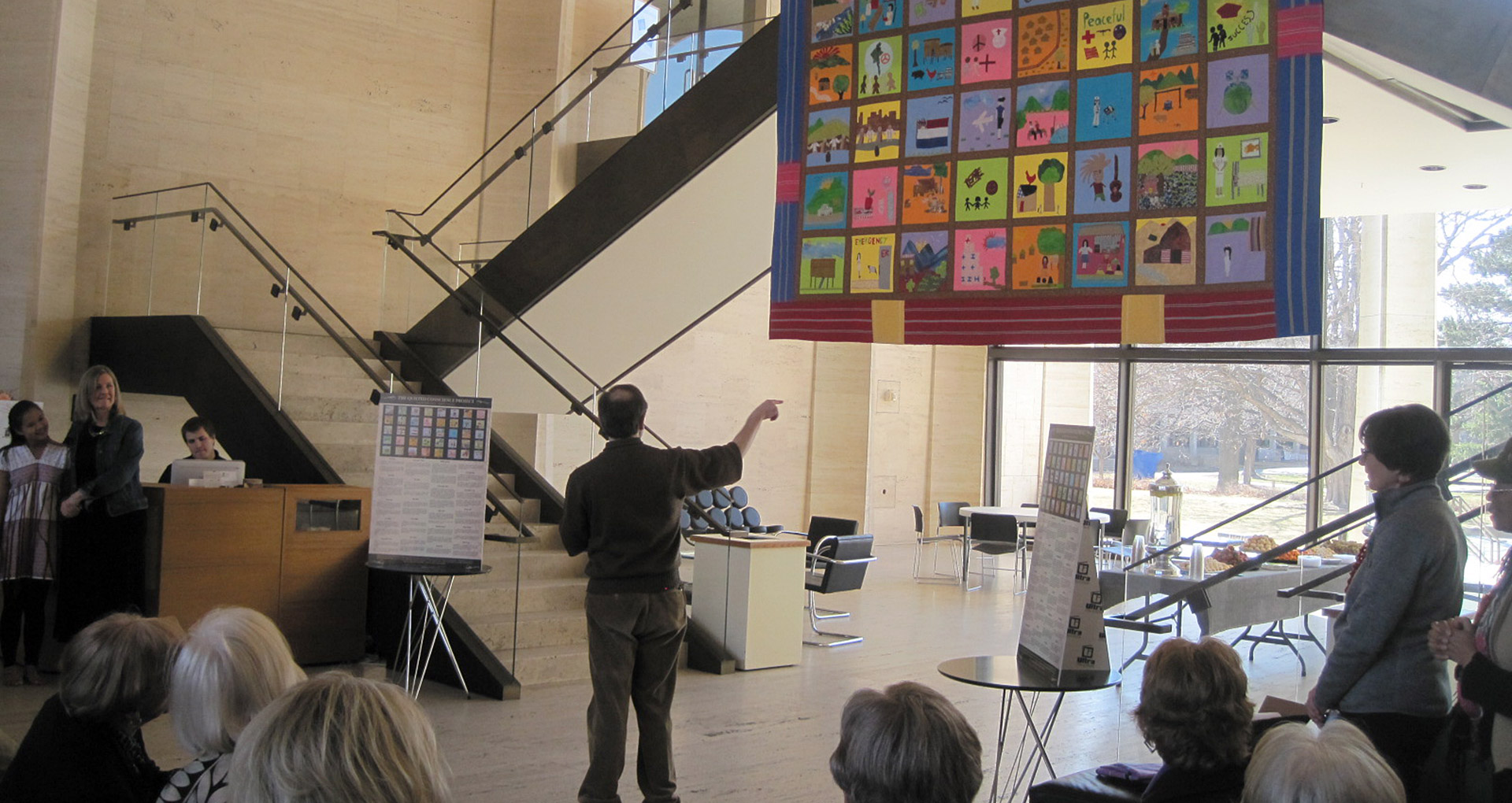 TQC Project Director John Sorensen introduces the quilt. Courtesy Christine Lesiak