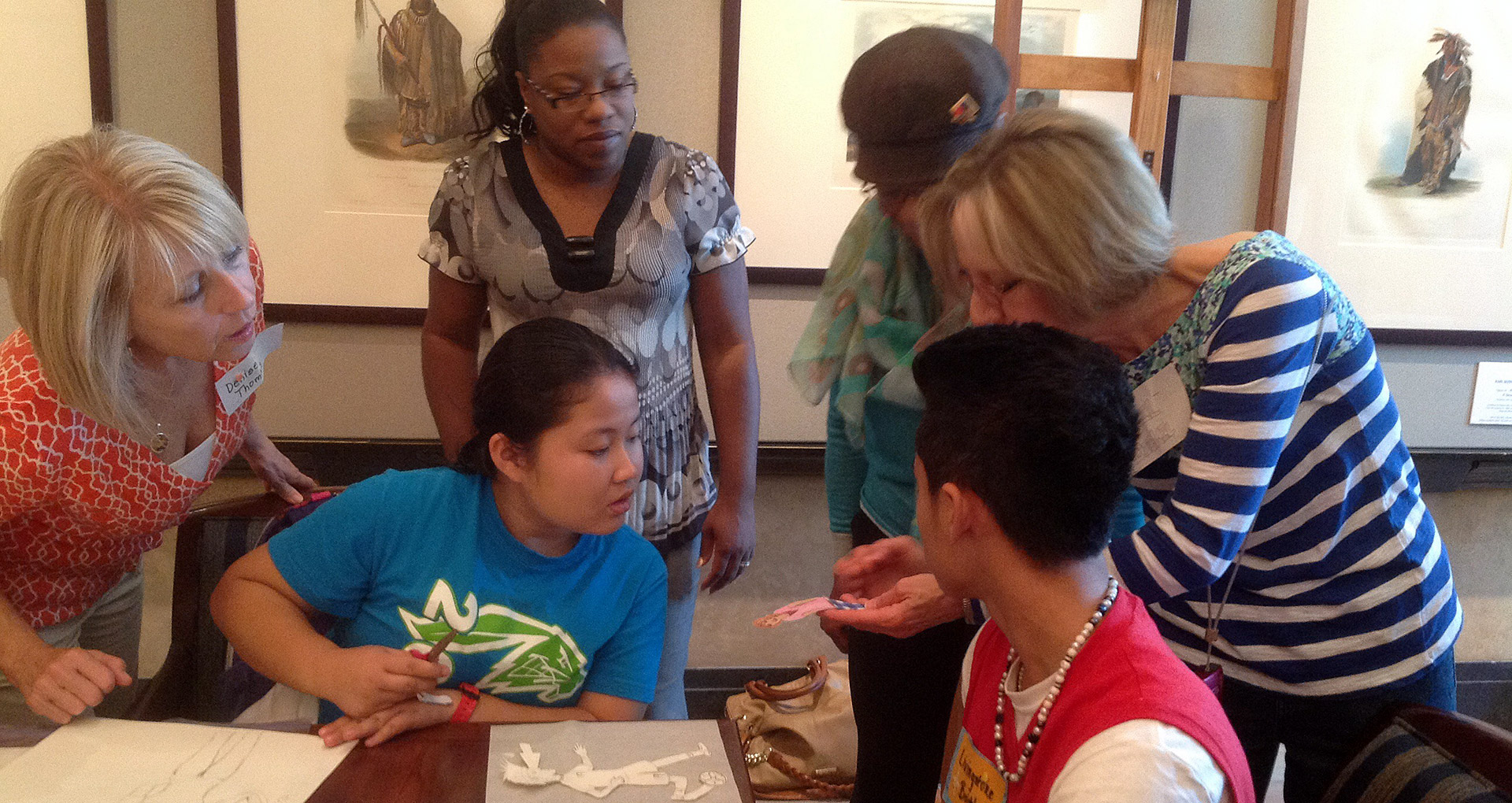 Traditional quilters help young quilters with their appliqué pieces. Courtesy Joslyn Art Museum